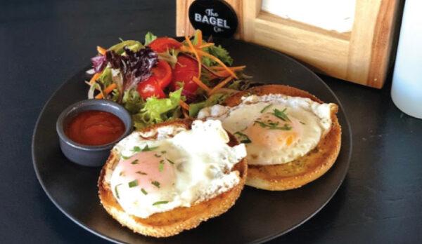 Fried eggs on bagel breakfast from The Bagel Co Rose Bay