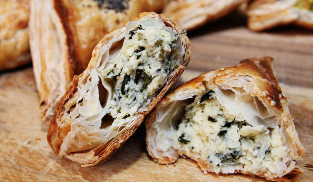 Baked filled Cheese n' Spinach Bourekas – pastries made of a flaky dough and filled with a variety of savory fillings, including cheese &spinach, vege and potato. They are great as appetizers, alongside a meal, or as a portable snack in their own right.